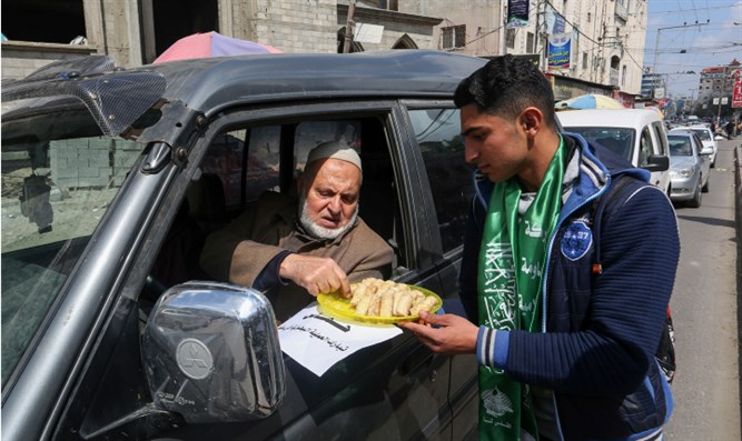 Hamas supporters hand out candies and pastries in Rafah, Gaza