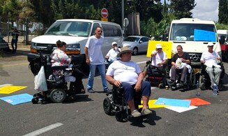Israel's disabled block road to airport