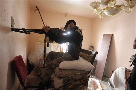 Free Syrian Army fighter aims his weapon, Ale